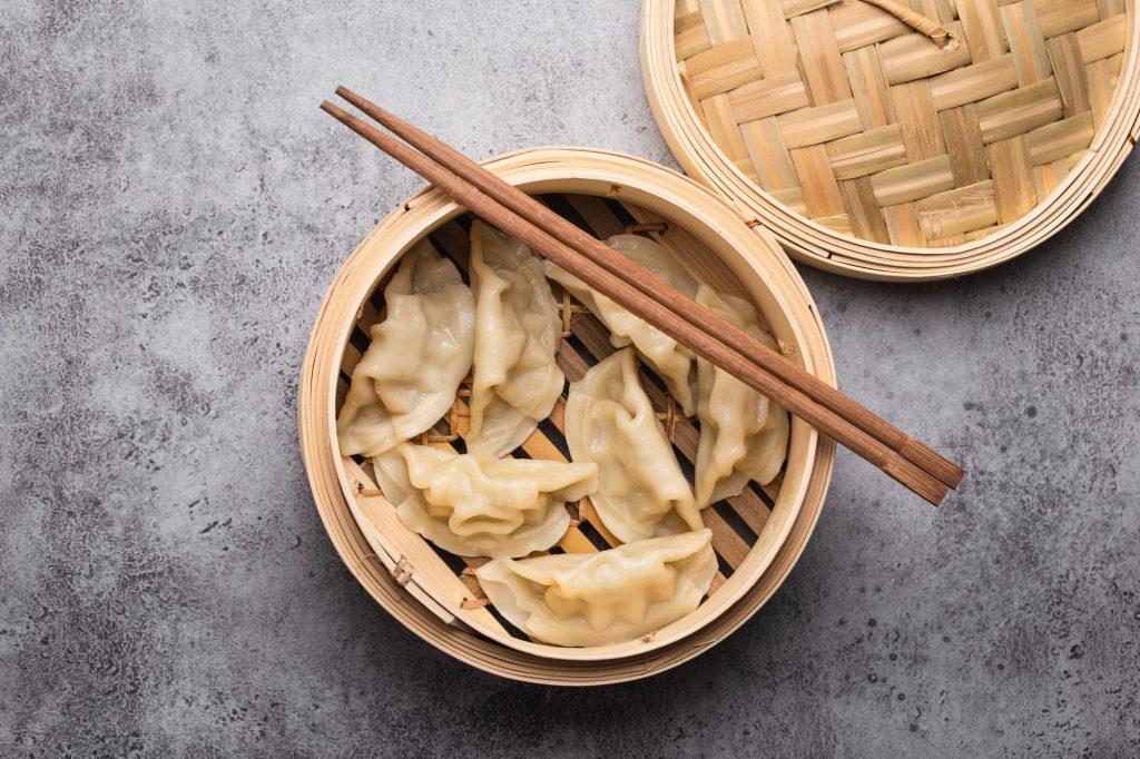 Asian dumplings in bamboo steamer