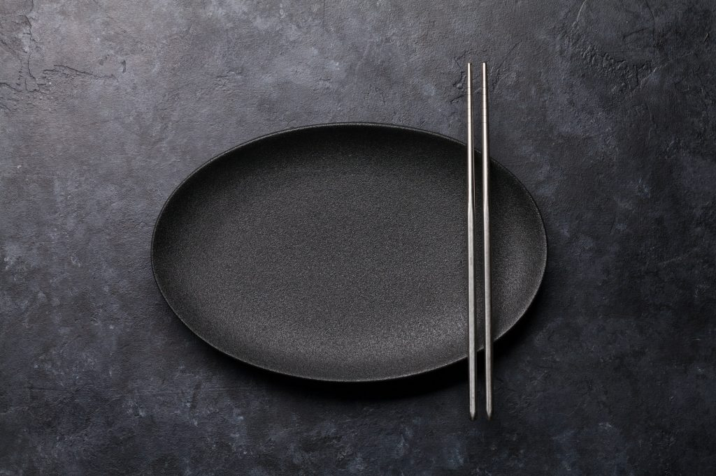 Empty plate and chopsticks