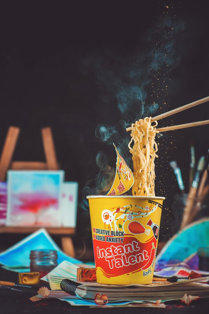 Instant ramen paper cup with chopsticks and Instant Talent label. Inspiration and creativity concept